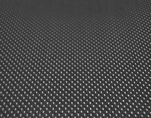 Black mesh on the back support of an office chair