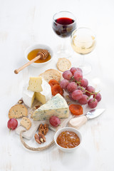 molded cheeses, fruit and snacks on a white wooden table