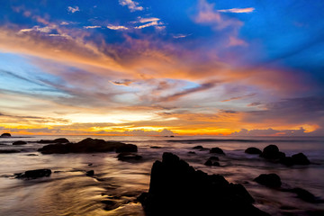 The colorful sunset at the stones beach.