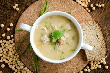white plate pea soup round board flatlay