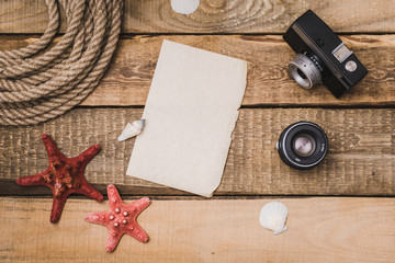 Holiday background with paper, rope and a camera