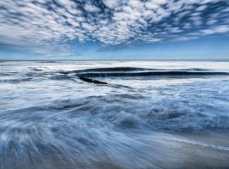Fototapete - Wellen und Wolkenbewegungen
