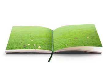 World environment day concept: Open book of nature in a beautiful green meadow on white background