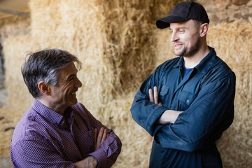 Farmer and vet talking at barn
