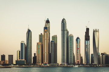 Dubai Marina skyline at sunset. View over the famous towers.