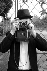 Retro style photographer with old camera. Young hotographer. Photographer holding old retro vintage camera. Black and white photography