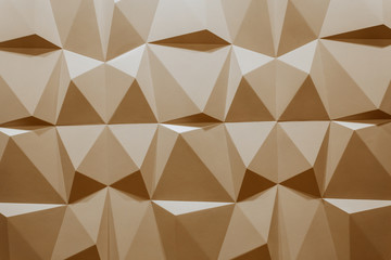 abstract wallpaper or geometrical background consisting of warm or orange geometric shapes: triangles and polygons