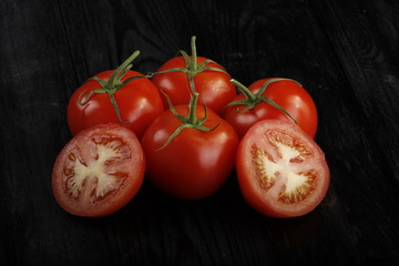 tomatos on wooden background