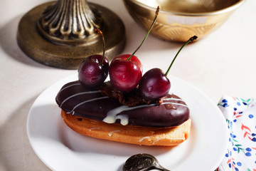 shortbread cake with chocolate eclair a cherry