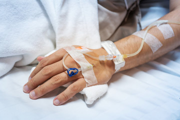 Patient hand with saline solution