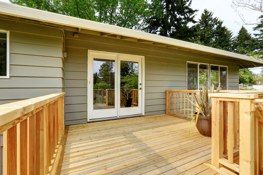 Countryside house with wooden walkout deck