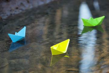 Blue paper boat in water