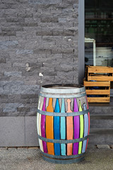 Colorful painted barrel in front of a shop