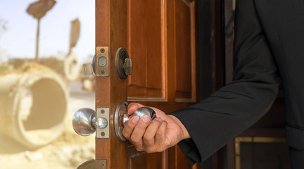 businessman open the door to road construction site