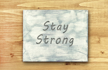 Motivational phrase note, Stay Strong sign.