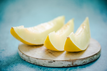 honeydew melon wedges sliced on board