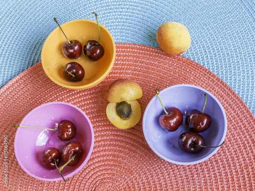 """sweet cherries in colored bowls and apricot"""" Stock photo and royalty ..."""