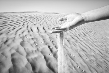 Sand in hand black and white