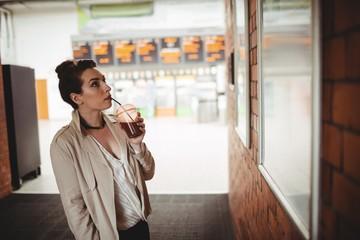 Woman looking towards board at railroad station