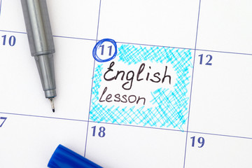 Reminder English lesson in calendar with pen
