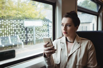 Woman sitting in train