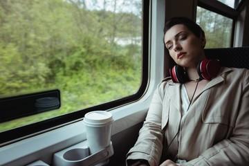 Young woman sleeping in train