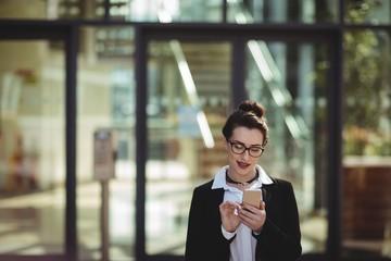 Businesswoman using cellphone Wall mural