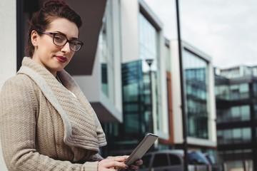 Portrait of woman holding digital tablet