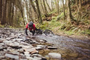 Mountain biker fallen in stream