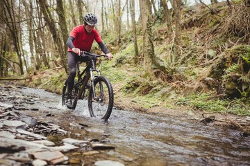 Front view of mountain biker in stream