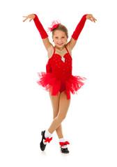 Dancer: Little Girl Performer Strikes Finish Pose In Costume
