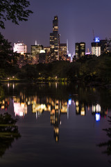 Night cityscape of Manhattan from Oak Bridge in Central Park, vertical view