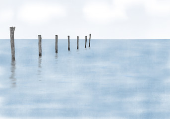 Abstract painted wooden pillars in the sea with reflections