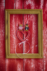 Wooden frame with carved wooden heart inside