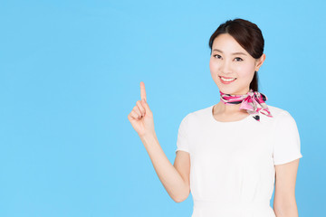 portrait of asian business woman isolated on blue background