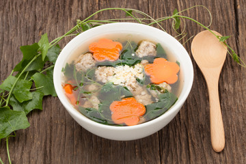 soup with pork and gourd on wooden background