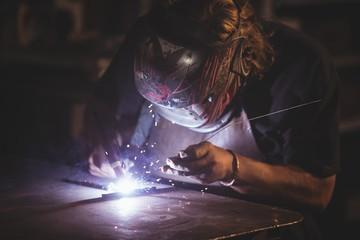 Blacksmith working at work shop