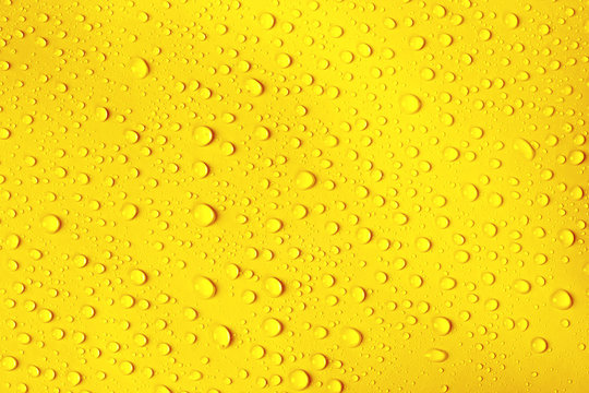 water drop on fresh yellow background