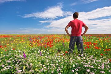 Man in spring meadow of flower.