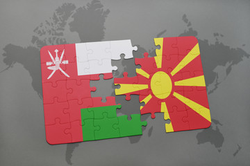 puzzle with the national flag of oman and macedonia on a world map background.