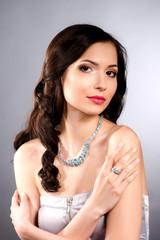 Glamour portrait of young beautiful fashion woman posing in exlu