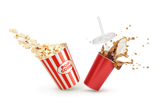 Red Paper cup with cola splash and falling Popcorn in box isolat