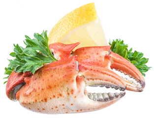 Cooked crab claws with lemon and herbs.