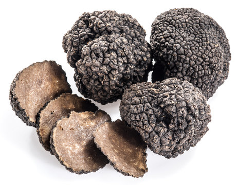 Black truffles isolated on a white background.