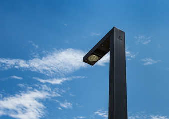 Modern street lighting against blue sky - bottom view