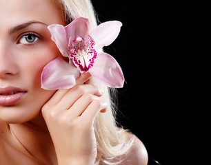 face of woman and orchid