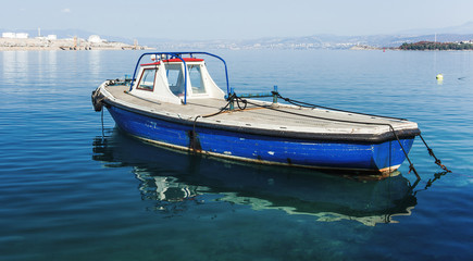fishing boat parked at the mediterranean sea