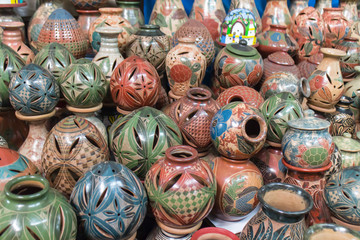 Ceramic handycrafts sold in the shops along the main road of San Juan Oriente in the highlands between Granada and Masaya, Nicaragua. Shallow depth of field