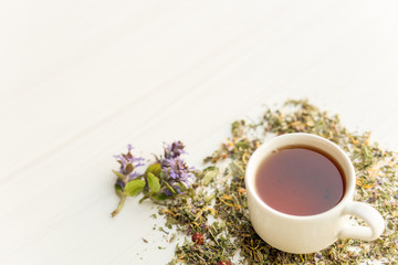 Cup of tea on table with herbs
