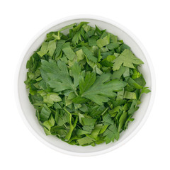 bowl of chopped parsley leaves isolated on white background